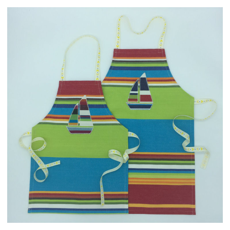 Children's striped apron available in 2 sizes with boat or beach hut motif