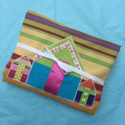 Beach Hut 'n Boats brightly striped large apron folded for postage