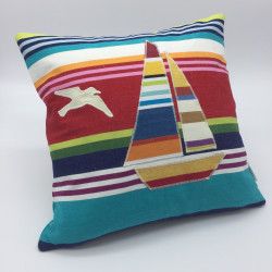 Striped square cushions with beach huts, boats and anchor designs.