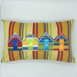 Striped cushions with beach hut, boat and anchor designs.